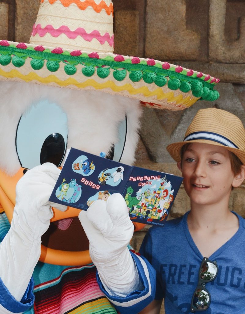 signing autographs with donald